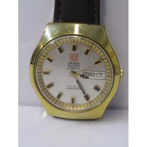 405 - OMEGA WRIST WATCH, electronic 300HZ Geneve chronometer with day date aperture, appears in working co...