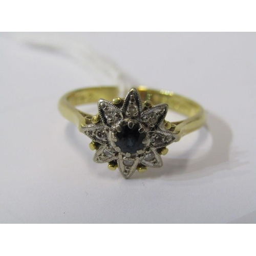 407 - 18ct YELLOW GOLD SAPPHIRE & DIAMOND STAR CLUSTER RING, principal sapphire surrounded by accent diamo...