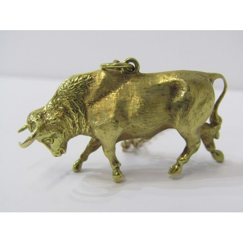 410 - GOLD BULL PENDANT, unusual gold bull, indistinct mark, tests high carat, on tests 9ct yellow gold ch...