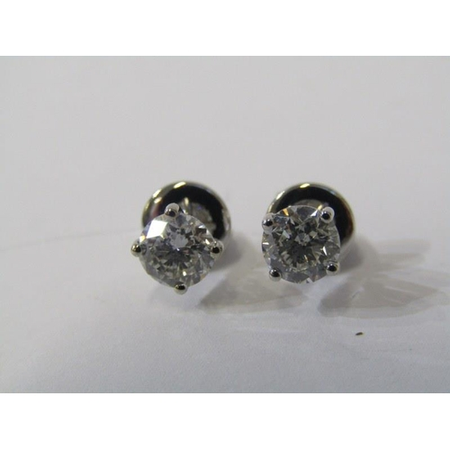 412 - PAIR OF 18ct WHITE GOLD DIAMOND STUD EARRINGS, total diamond weight approx. 1.3ct, bright well match...