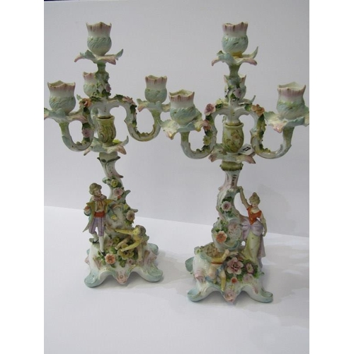 42 - THURINGIAN, pair of triple branch figure base floral encrusted candelabra (restored), 16