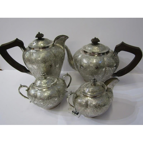 634 - EASTERN TEA SET, ornate 4 piece Eastern tea set with wooden handles and knobs, the elaborately engra...