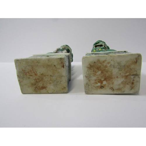 64 - ORIENTAL CERAMICS, pair of Chinese famille verte temple dogs on plinths, 6