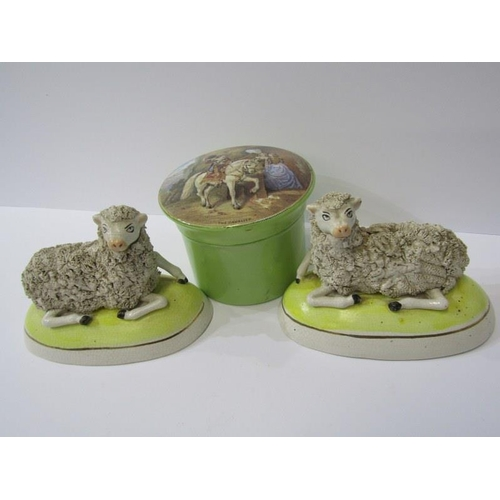 68 - STAFFORDSHIRE POTTERY, pair of encrusted pottery Sheep figures on oval yellow ground bases, 5.5