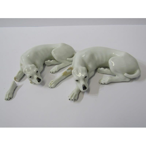72 - CONTINENTAL PORCELAIN, 2 figures of sleeping Hounds, blue asterix mark (some damage), 5