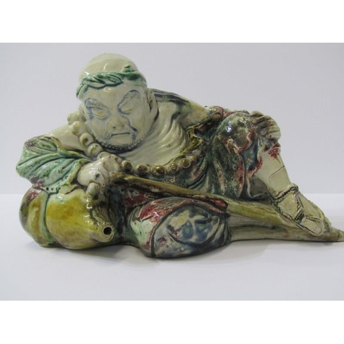 97 - ORIENTAL CERAMICS, Chinese glazed pottery figure of Resting Traveller, 8