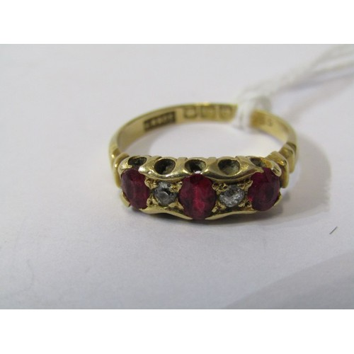 379 - 18CT YELLOW GOLD RUBY & DIAMOND RING, 3 principal oval cut rubies each separated by old cut diamond ...
