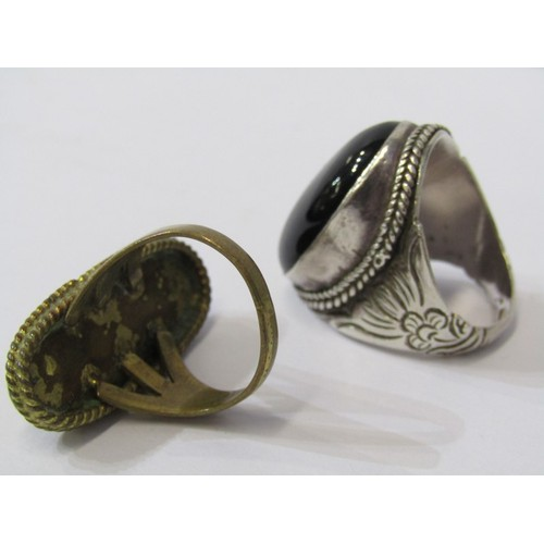 395 - SILVER RINGS, large onyx style silver ring & one tigers eye on yellow metal ring...