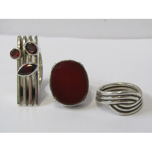 397 - SILVER RINGS, one large stone set designer style silver ring, one carnelian ring & one band ring, 3 ...