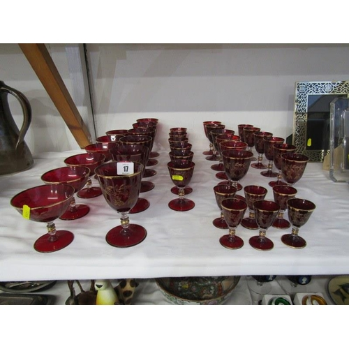 17 - GLASSWARE, large collection of gilded ruby glass tableware...