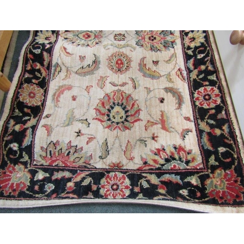 486 - RUNNER RUG, with floral decoration on a beige ground within blue floral border, 31