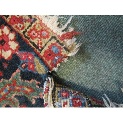 615 - LARGE MIDDLE EASTERN CARPET, with multiple motifs on a red ground, within 3 main borders, approx 152...