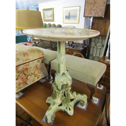 102 - ORNATE POTTERY WINE TABLE, floral and foliate design base tripod wine table with floral painted dish...