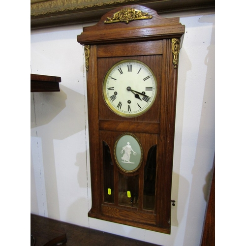129 - WALL CLOCK, a quality oak framed wall clock with enamelled dial & Roman numerals, the case with Jasp...