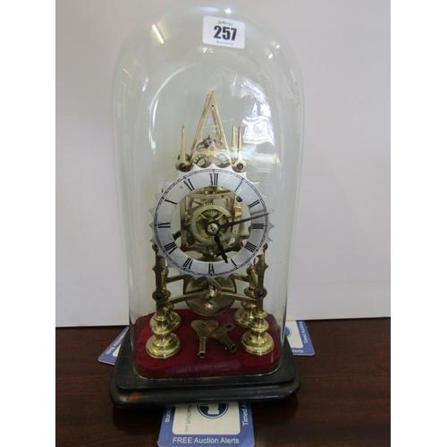 257 - SKELETON CLOCK, glass domed brass skeleton clock, 11