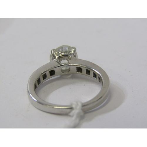 314 - PLATINUM SET DIAMOND SOLITIAIRE RING, principal transitional brilliant cut diamond of good colour wi...