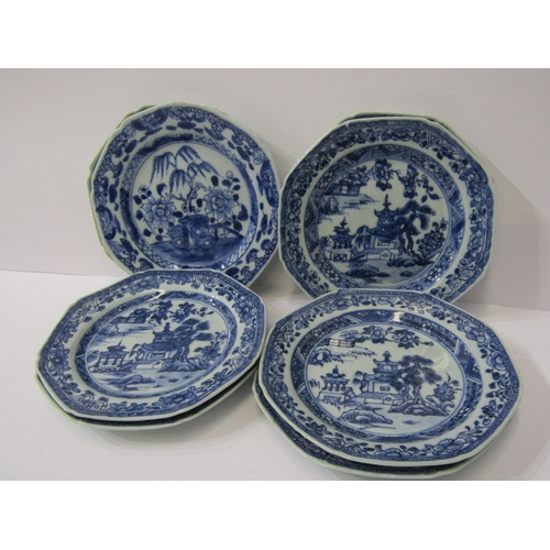 39 - CHINESE PLATES, a set of 7 Chinese underglaze blue octagonal plates, decorated pagodas and 1 similar...