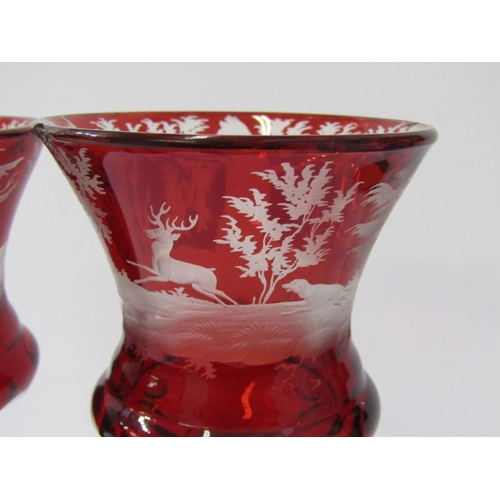43 - BOHEMIAN GLASS, pair of 19th Century etched ruby glass goblets, with decorated with stag hunts octag...