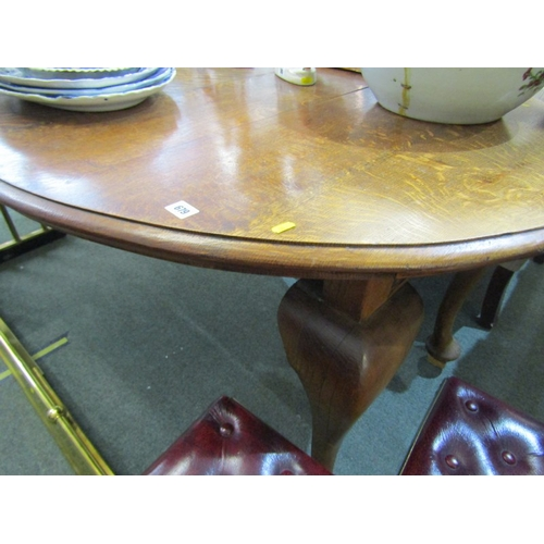 679 - EDWARDIAN OAK OVAL EXTENDING DINING TABLE, cabriole legs, 42