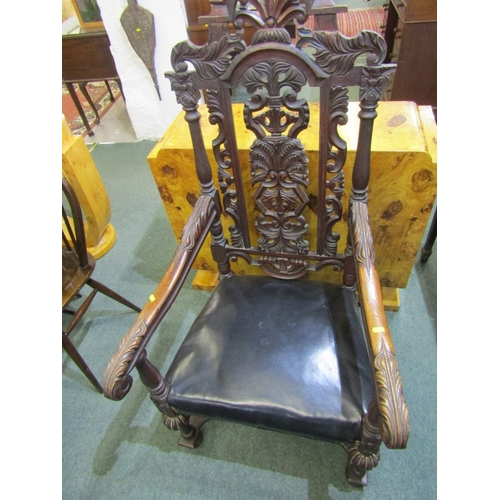 681 - CAROLEAN DESIGN, carved oak open armchair, foliate cresting, with carved supports and shaped X stret...