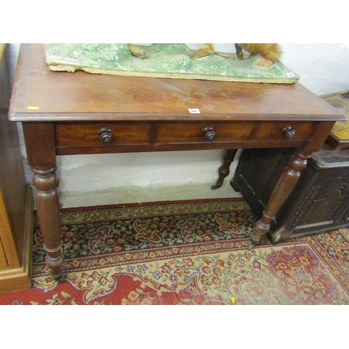 687 - VICTORIAN MAHOGANY TRIPLE DRAWER DESK, original wood knop handles and tapering turned legs with bras...