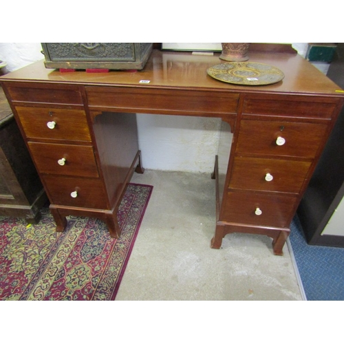 693 - ART DECO MAHOGANY KNEEHOLE DESK, turned ivory knop handles with drop front central frieze drawer and...