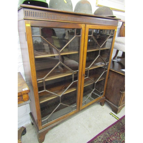 695 - GEORGIAN DESIGN MAHOGANY GLAZED TWIN DOOR BOOKCASE, fluted pediment with glazing in the Chippendale ...
