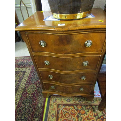 701 - REPRODUCTION cross banded mahogany serpentine fronted 4 drawer bedside chest, brass ring drop handle...