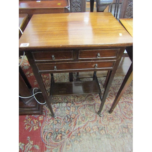 710 - MAHOGANY TRIPLE DRAWER NEEDLEWORK TABLE, open shelf base with tapering square section legs and brass...