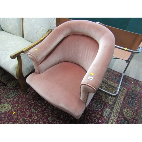719 - EDWARDIAN TUB ARMCHAIR, upholstered in pink draylon with tapering turned legs and original castors