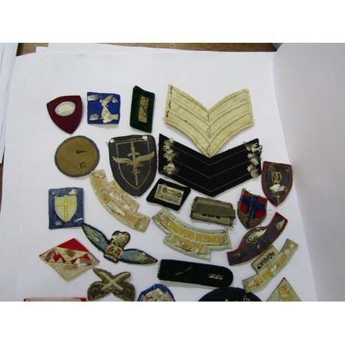 160 - MILITARY, A collection of embroidered cloth military badges including several with Nazi emblems