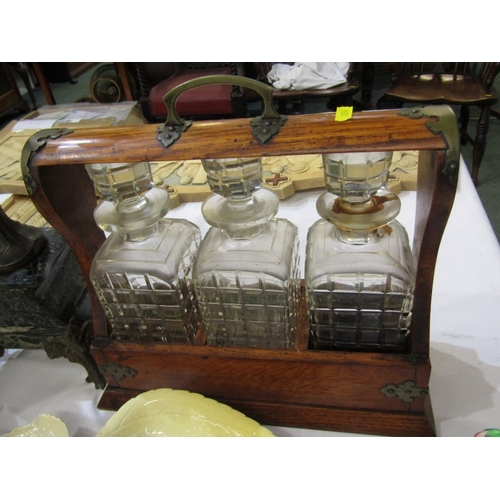 241 - EDWARDIAN TANTALUS, triple decanter tantalus with plated mounts and key, 13