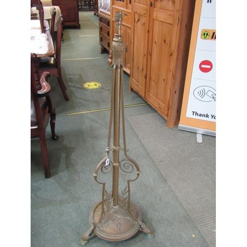 260 - METALWARE, late Victorian brass adjustable standard lamp base, triple foliate decorated scroll feet