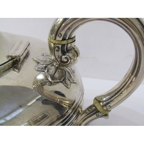 501 - WILLIAM IV SILVER TEAPOT, compressed circular form with floral finial and foliate hand terminal, Lon...