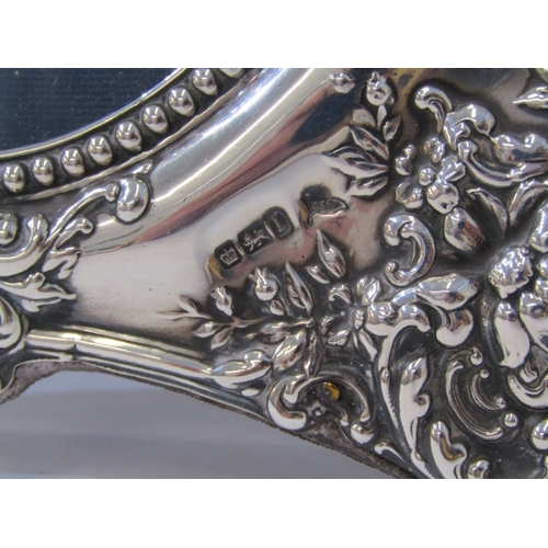 503 - SILVER PHOTO FRAME, Edwardian HM silver easel photo frame with ornate floral embossed decoration, Sh...