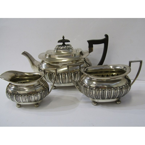 504 - WALKER & HALL SILVER TEA SERVICE, Regency design fluted rectangular base 3 piece tea service, ebonis...