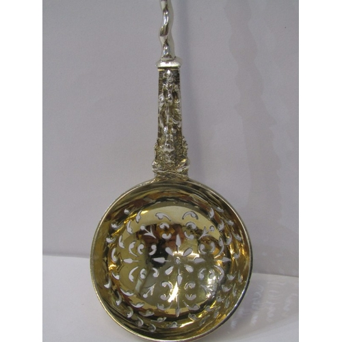 514 - VICTORIAN SILVER APOSTLE CRESTED SUGAR SIFTER SPOON with gilt pierced bowl, London 1889