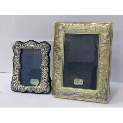 541 - SILVER PHOTO FRAMES, 2 modern boxed photo frames, 1 decorated with Rabbits and Storks, 17cm height, ...