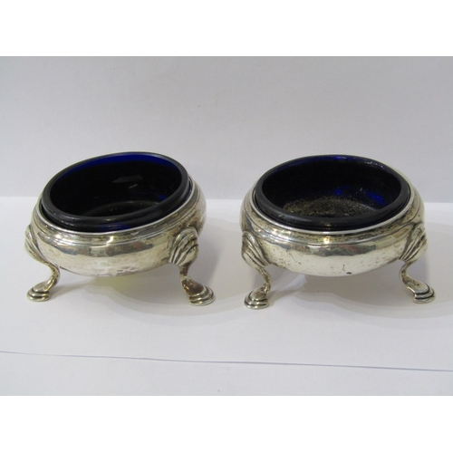 542 - PAIR OF GEORGIAN SILVER SALTS of circular form with blue glass liners, London HM (marks worn), 6cm d...