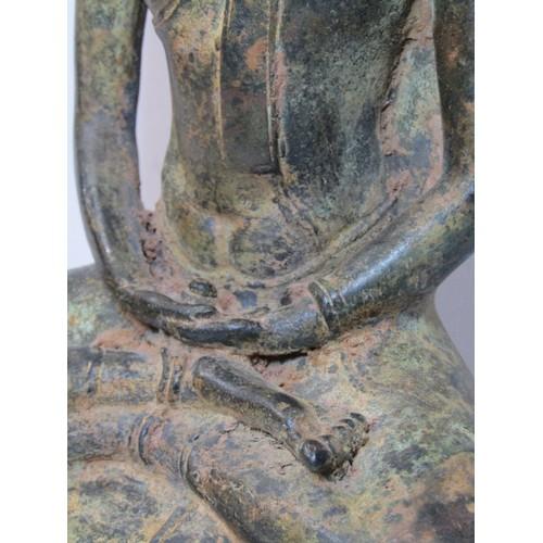 172 - EASTERN METALWARE, copper figure of seated Deity, 12
