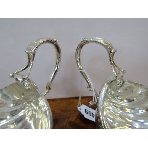 499 - SILVER GRAVY BOATS, matched pair of scolloped bowl gravy boats on pedestal stems, makers C,S & S, 6....