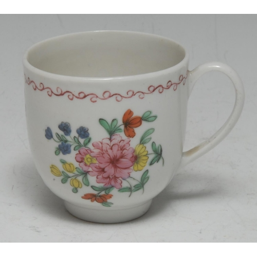 21 - A Bristol bell-shaped coffee cup, painted in polychrome enamels with scattered country flowers below...