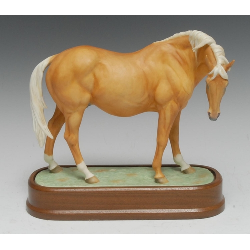 40 - A Royal Worcester Palomino Thoroughbred Mare,  model by Doris Lindner, 20cm high, plinth base,  limi...