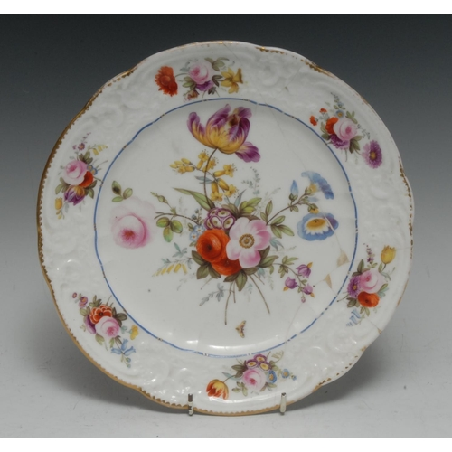 41 - A Nantgarw shaped circular plate, the centre painted with a spray of country flowers, the border in ...
