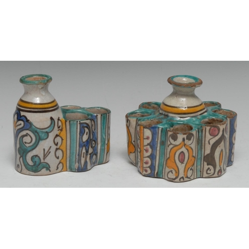 5 - A Persian tin-glazed stoneware inkwell, as a stylized flower, painted in the Islamic taste with rese...