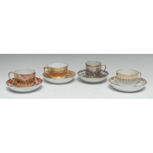 52 - A New Hall coffee cup and saucer, decorated in polychrome with stylised foliage, picked out in gilt,...