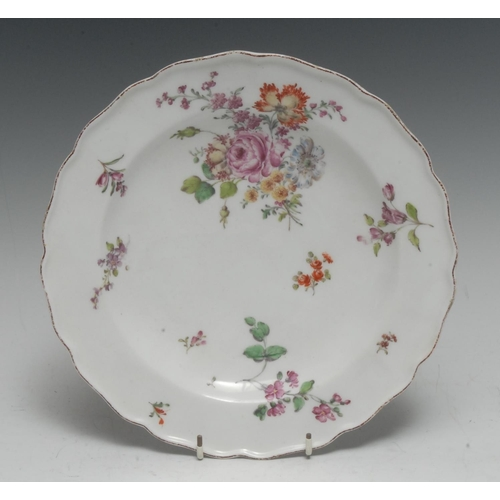 55 - A Chelsea shaped plate, painted in Meissen style with a large bouquet and scattered flower sprays, i...