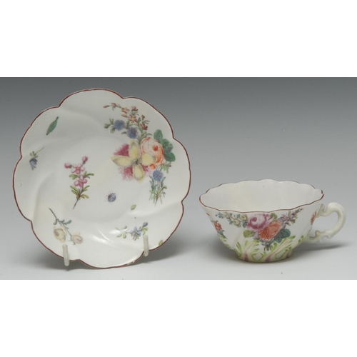 58 - A Chelsea teacup and saucer, spirally-fluted and moulded in relief with fronds of leaves picked out ...