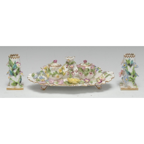62 - A Coalbrookdale-type porcelain inkstand, centred by a taper stick and flanked by a pair of wells, th...