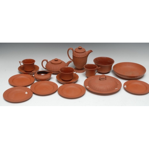 7 - A mid 19th century Wedgwood Red Stoneware tea service, of lobed form, comprising teapot and cover, m...